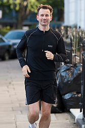 © Licensed to London News Pictures. 14/06/2012. LONDON, UK. Conservative MP Jeremy Hunt, the British Government's Secretary of State for Culture, Olympics, Media and Sport is seen running near his London home today (14/06/12). Photo credit: Matt Cetti-Roberts/LNP