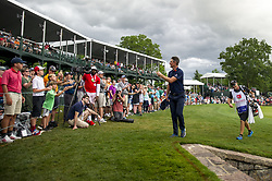 May 5, 2019 - Charlotte, North Carolina, United States of America - Justin Rose tosses his golf ball to a young fan while exiting the eighteenth green after finishing his round during the final round of the 2019 Wells Fargo Championship at Quail Hollow Club on May 05, 2019 in Charlotte, North Carolina. (Credit Image: © Spencer Lee/ZUMA Wire)