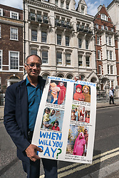 August 14, 2017 - London, UK - London, UK. 14th August 2017. A lawyer who visited Korba 3 months after the disatrous chimney collapse holds a poster with his photographs of some of the widows at the protest by Grass roots campaign Foil Vedanta outside the Vedanta AGM. They accuse Vedanta of illegal mining in Goa, of increasing harassment, torture and false accusations against tribal activists in Nyamgiri,  Odisha, who have used Indian laws to stop bauxite mining of their sacred mountain,  eleven years of ruinous and continuing pollution by Konkola Copper Mines (KCM) in Zambia, where they say the company have fraudulently avoided taxes and failed to publish mandatory accounts and other offences. Vedanta is a FTSE 250 British mining company controlled and 69.6% owned by Anil Agarwal and his family through a series of tax havens and holding companies and was launched on the Stock Exchange in 2003 with help from the UK's Department for International Development (DfID) and Department of Trade and Industry (DTI) who continue to support it. Foil Vedanta call for the company to be delisted and shareholder activists went into the AGM to question its activities. Peter Marshall ImagesLive (Credit Image: © Peter Marshall/ImagesLive via ZUMA Wire)