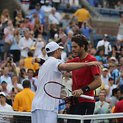 Andy Roddick, USA, is embraced by Juan Martin Del Potro, Argentina, during the US Open Tennis Tournament, Flushing, New York. USA. 5th September 2012. Photo Tim Clayton