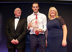 CARDIFF, WALES - Monday, October 5, 2015: Wales' Gareth Bale receive the Player of the Year Award from FAW President David Griffiths and Vauxhall's Cheryl Stibbs during the FAW Awards Dinner at Cardiff City Hall. (Pic by David Rawcliffe/Propaganda)