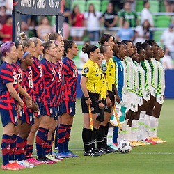 The USA and Nigerian teams line up for introductions before the US Women's National Team (USWNT) beats Nigeria, 2-0 in the inaugural match of Austin's new Q2 Stadium. The U.S. women's team, an Olympic favorite, is wrapping up a series of summer matches to prep for the Tokyo Games.