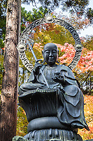 Guardian Deity of Longetivity - Enmei Jizo holding a Buddhist ringed staff in his right hand, and a wishing jewel in his left.  He is sitting on a lotus leaf.  The statue is modeled after Chuho Myosai former monk at Zuiganji Temple who was blssed with a long life.  He devoted his life to providing sactuary for young children, notably during times of famine.