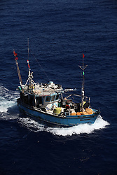 INDIAN OCEAN 24MAR13 - An unidentified Sri Lankan fishing vessel (IMUL-A-0430 CHW) runs at full speed in the Chagos EEZ in the Indian Ocean.<br /> <br /> <br /> <br /> The Greenpeace ship Esperanza is on patrol in the Indian ocean documenting illegal fishing vessels.<br /> <br /> <br /> <br /> jre/Photo by Jiri Rezac / Greenpeace