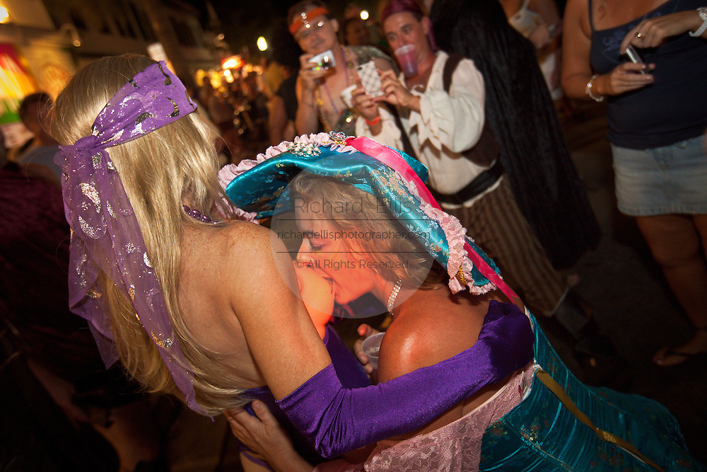 Topless revelers during Fantasy Fest halloween parade in Key West, Florida.