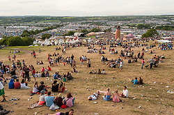 © Licensed to London News Pictures. 25/06/2015. Pilton, UK. Festival atmosphere at Glastonbury Festival 2015 on Thursday Day 2 of the festival, near sunset.  This years headline acts include Kanye West, The Who and Florence and the Machine, the latter having been upgraded in the bill to replace original headline act Foo Fighters.   Photo credit: Richard Isaac/LNP