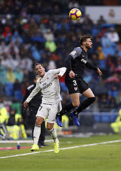 January 19, 2019 - Madrid, Madrid, Spain - Lucas Vazquez (Real Madrid) and  Sergi Gomez (Sevilla FC) are seen in action during the La Liga match between Real Madrid and Sevilla FC at the Estadio Santiago Bernabéu in Madrid. (Credit Image: © Manu Reino/SOPA Images via ZUMA Wire)