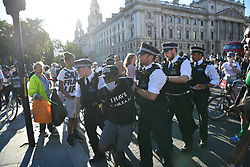 © Licensed to London News Pictures. 31/05/202. A man is arrested as police react to protestors. Demonstrators gathered Parliament in London, protesting the police killing of George Floyd, an unarmed black man in Minneapolis who died in police custody while an officer kneeled on his neck to pin him down. Photo credit: Guilhem Baker/LNP