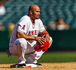 ANAHEIM, California/USA (Thursday, September 27, 2012) - Los Angeles Angels first baseman Albert Pujols #5 plays during the Mariners vs. Angels game held at the Angels  Stadium. The Angels lost 9-4. Byline and/or web usage link must read PHOTO © Eduardo E. Silva/SILVEX.PHOTOSHELTER.COM.