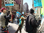 Protestors taking a sign New York City No War on Iraq Protest March 22 2004