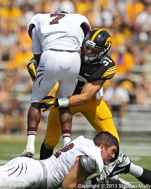 September 07 2013: Missouri State Bears running back Vernon Scott (7) is hit by Iowa Hawkeyes linebacker Anthony Hitchens (31) during the second quarter of the NCAA football game between the Missouri State Bears and the Iowa Hawkeyes at Kinnick Stadium in Iowa City, Iowa on September 7, 2013. Iowa defeated Missouri State 28-14.