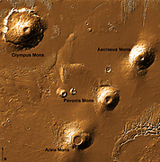 Shaded relief image derived from Mars Orbiter Laser Altimeter data, which flew on-board the Mars Global Surveyor. The image shows Olympus Mons and the three Tharsis Montes volcanoes: Arsia Mons, Pavonis Mons, and Ascraeus Mons from southwest to northeast.