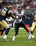 Houston defensive end Antwan Peek (98) fights off a block from St. Louis Rams tackle Alex Barron (70) in the first half at the Edward Jones Dome in St. Louis, Missouri, August 19, 2006.  The Texans beat the Rams 27-20.