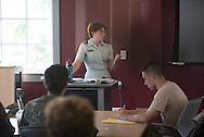 Photos showing a mix of corps and civilian students working together and in class.