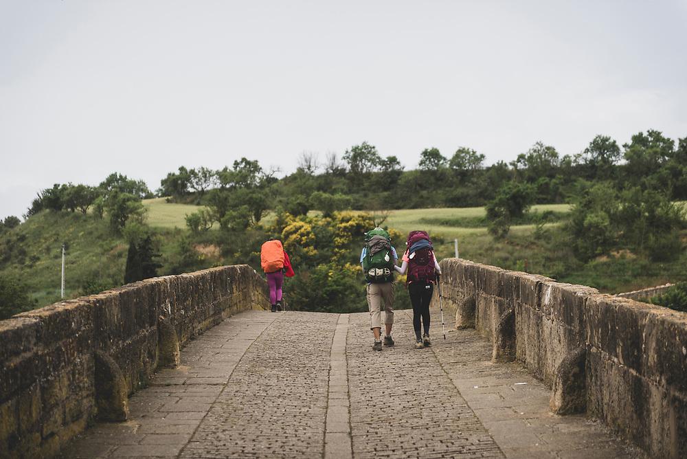 Pilgrims begin another morning on the Camino de Santiago, departing Puenta la Reina via the 11th-century Romanesque bridge.<br /><br />(June 4, 2018)