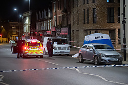 © Licensed to London News Pictures. 10/04/2021. London, UK. A police vehicle parked near a tent that covers the body of a 17-year-old boy who was fatally stabbed in Sydenham. Police were called to Hazel Grove, junction with Sydenham Road, at 19:19BST on Saturday, 10 April after reports of a male lying injured on the ground. Officers attended with medics from the London Ambulance Service and the London Air Ambulance. They found a 17-year-old male who had been stabbed. Despite the best efforts of the emergency services, he was pronounced dead shortly after 20:00BST. Photo credit: Peter Manning/LNP