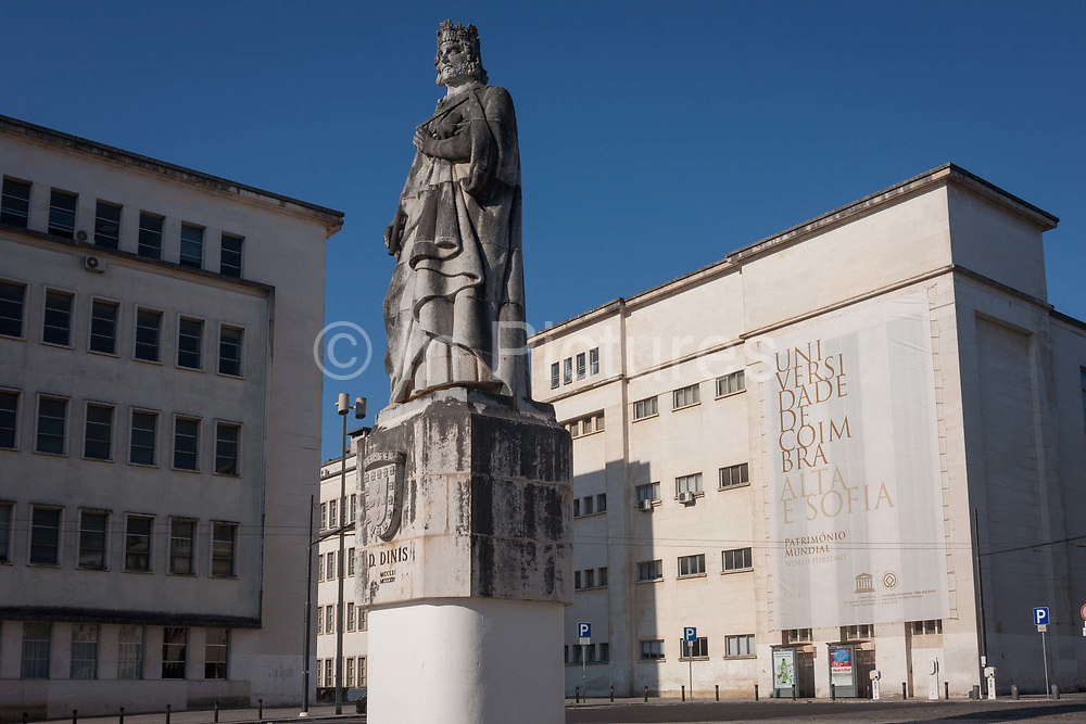 Statue of King Dinis with the exteriors of the Department of Mathematics on the left, and the Faculty of Science and Technology to the right, on Largo D. Dinis in Coimbra University, on 17th July, at Coimbra, Portugal. King Dinis founded a university in 1290 and transferred it to Coimbra in 1537 where theology, medicine and law were mostly studied. It is now a UNESCO World Heritage Site.