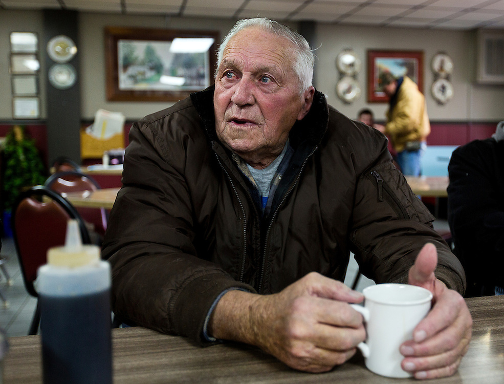 "MONTICELLO, IA – JANUARY 6: Sitting at the ""Table of Knowledge"" LaRoy Rickeln looks on over breakfast at Darrell's in Monticello, Iowa on January 6, 2017."
