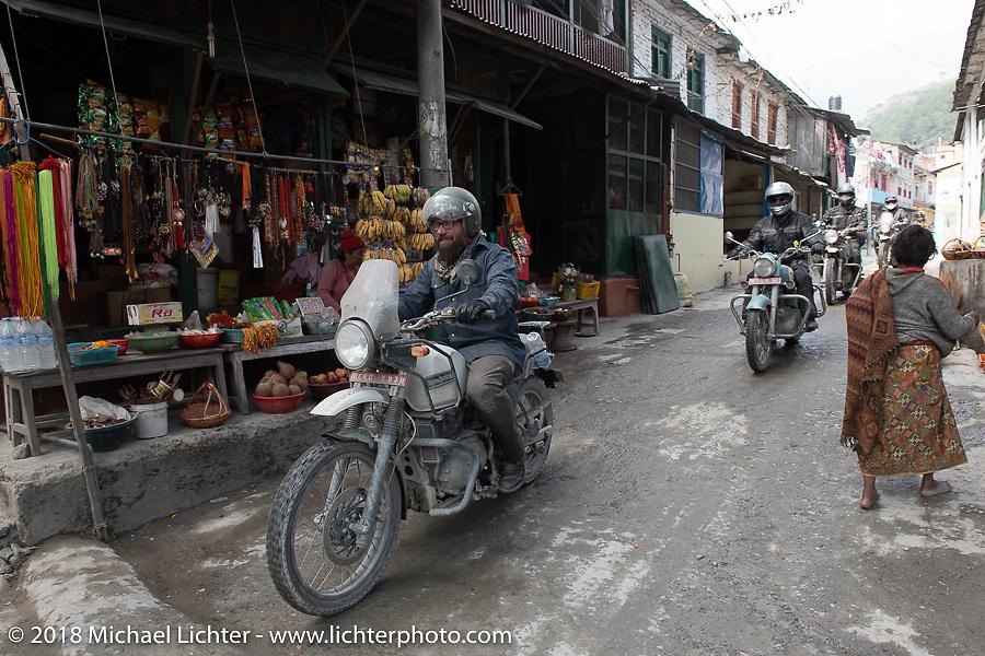 Bear Haughton passing through Modibeni on Day-7 of our Himalayan Heroes adventure riding from Tatopani to Pokhara, Nepal. Monday, November 12, 2018. Photography ©2018 Michael Lichter.