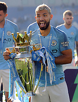 Football - 2018 / 2019 Premier League - Brighton & Hove Albion vs. Manchester City<br /> <br /> Sergio Aguero of Man City sticks his tongue out with the trophy, at The Amex.<br /> <br /> COLORSPORT/ANDREW COWIE