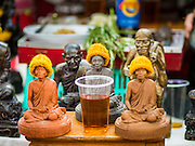 27 NOVEMBER 2015 - BANGKOK, THAILAND:  A Buddhist shrine in an amulet vendor's street stall on Maharat Road in Bangkok. Hundreds of vendors sell amulet and Buddhist religious paraphernalia to people in the Amulet Market, a popular tourist attraction along Maharat Road north of the Grand Palace near Wat Maharat in Bangkok. Bangkok municipal officials announced that they are closing the market and forcing vendors to relocate to an area about one hour outside of Bangkok. The closing of the amulet market is the latest in a series of municipal efforts to close and evict street vendors and markets from areas that have potential for redevelopment. The street vendors will be evicted from the area by Sunday, Nov. 29.   PHOTO BY JACK KURTZ