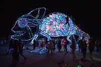 Come-Million! by: Amit Weissenstern from: Tel-Aviv, IS year: 2018 Come-Million is a giant colorful chameleon that shines up beautifully when playing interactively with her friends! Come-Million's skin is made of hundreds of tiles carrying thousands little lights. Their colors change in reaction to the participants' behavior inside, sensed through its pumping heart. A playful collaboration is demonstrated through the interaction between the people inside the chameleon, and passerby. Inside the chameleon there will be an interactive game that the visitors and the chameleon will participate in using a set of handles of different colors. Citizens of Black Rock City will sense and understand Come-Million's through its signals and listen to her heart – to help her shine with millions of colors. My Burning Man 2018 Photos:<br />