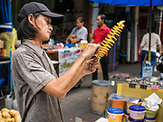 30 AUGUST 2014 - BANGKOK, THAILAND:  A street stall snack vendor prepares potato chips in the Chinatown section of Bangkok.       PHOTO BY JACK KURTZ