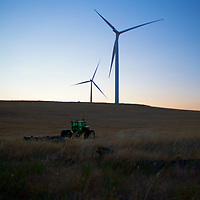 A tractor sits at a freshly harvested field atop the ridges of the Snake River Valley in Eastern Washington near Dodge.