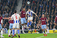 West Ham United defender Issa Diop (23) and Brighton and Hove Albion defender Shane Duffy (4) battle in the air with a header during the Premier League match between Brighton and Hove Albion and West Ham United at the American Express Community Stadium, Brighton and Hove, England on 5 October 2018.