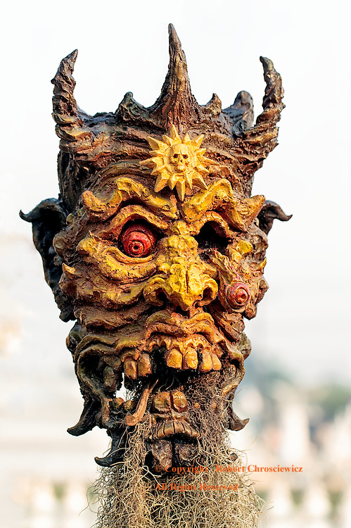Horror Mask:  A close up view of a horrific horned creature snarls at all that visit  Wat Rong Khun (better known as the White Temple), Chiang Rai Thailand.