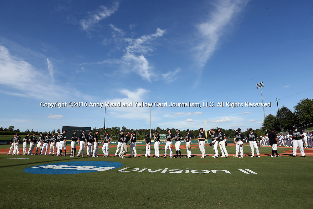 28 May 2016: Nova Southeastern's players and coaches are introduced before the game. The Nova Southeastern University Sharks played the Franklin Pierce University Ravens in Game 3 of the 2016 NCAA Division II College World Series  at Coleman Field at the USA Baseball National Training Complex in Cary, North Carolina. Nova Southeastern won the game 4-3 in twelve innings.