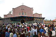 Africa, tanzania, A crowd of people outside the church in Karatu April 2006