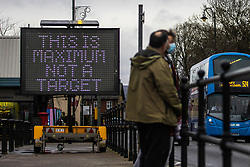 "© Licensed to London News Pictures. 23/12/2020. Bolton, UK. A sign in Bolton reads "" This is maximum not a target "" in reference to current government guidelines for Tier 3 regions that permit three households per Christmas bubble . Guidance is being presented to encourage people to celebrate Christmas safely and minimise the spread of Coronavirus . Photo credit: Joel Goodman/LNP"