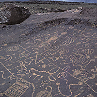 Ancient Native American drawings on volcanic tuff in CA's Owens Valley, Sierra bkg.