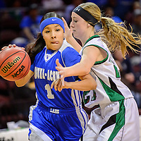 031015  Adron Gardner/Independent<br /> <br /> Laguna Acoma Hawk Shaylynn Smith (1), left, drives past Texico Wolverine Audrey Wren (21) during the New Mexico state basketball tournament at the Santa Ana Star Center  in Rio Rancho Tuesday.