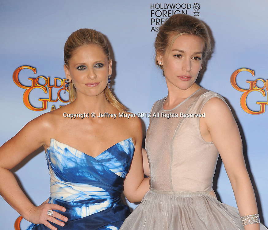 BEVERLY HILLS, CA - JANUARY 15: Sarah Michelle Gellar and Piper Perabo pose in the press room at the 69th Annual Golden Globe Awards held at the Beverly Hilton Hotel on January 15, 2012 in Beverly Hills, California.