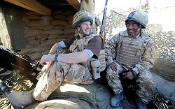 Prince Harry chats to a Gurkha soldier after firing a 50mm machine gun at Taliban fighters while posted in Helmand Province in Southern Afghanistan.