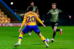 Ben Stevenson of Colchester United looks to get past Stephen McLaughlin of Mansfield Town - Mandatory by-line: Ryan Crockett/JMP - 20/11/2020 - FOOTBALL - One Call Stadium - Mansfield, England - Mansfield Town v Colchester United - Sky Bet League Two