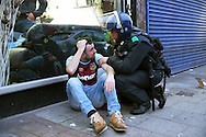 a Riot Police Officer attends to an injured West Ham United fan outside Boleyn Ground before k/o. scenes around the Boleyn Ground, Upton Park in East London as West Ham United play their last ever game at the famous ground before their move to the Olympic Stadium next season. Barclays Premier league match, West Ham Utd v Man Utd at the Boleyn Ground in London on Tuesday 10th May 2016.<br /> pic by John Patrick Fletcher, Andrew Orchard sports photography.