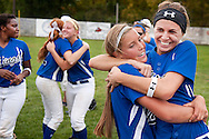 13 OCT. 2012 -- ST. PETERS, Mo. -- Francis Howell High School softball players Katie Prizer (11, right) and Theresa DeCosty (2) join their teammates in celebration after beating St. Joseph's Academy 10-5 in five innings to win the MSHSAA Class 4 quarterfinals at C-H Ballpak in St. Peters Saturday, Oct. 13, 2012.  Photo © copyright 2012 Sid Hastings.