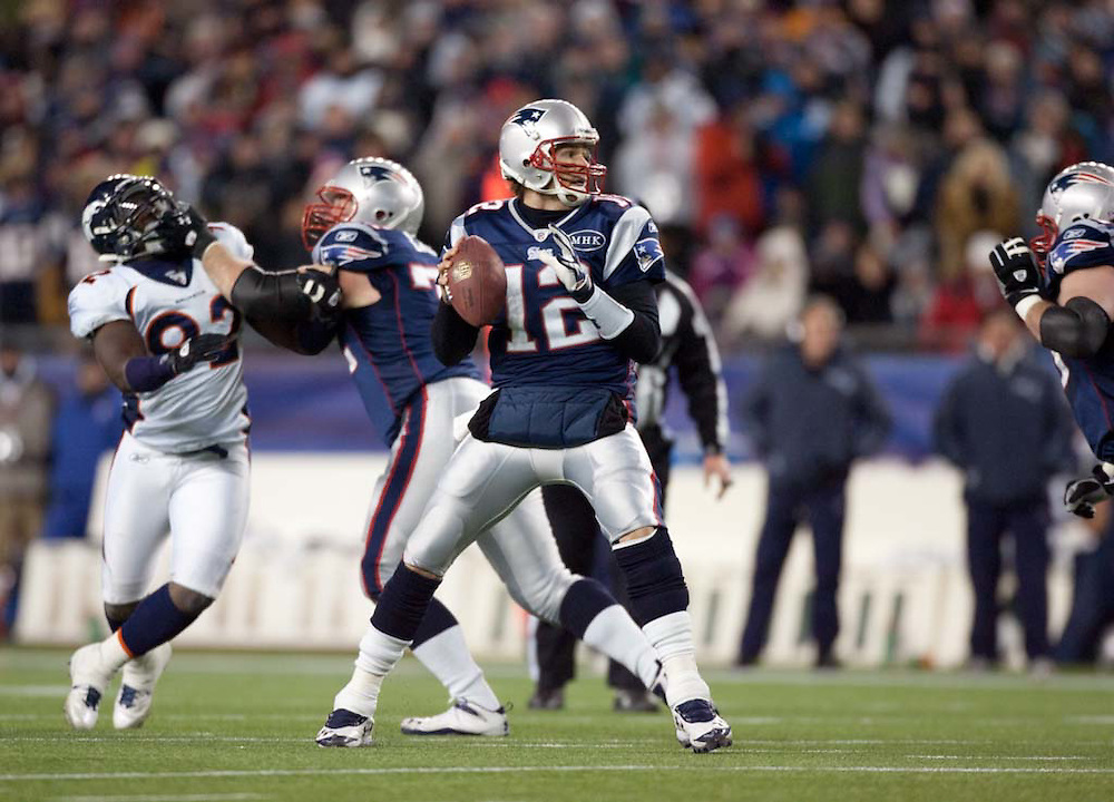 Foxborough, MA 01/14/2012.Patriots quarterback Tom Brady looks to pass in the first half of Saturday's AFC Divisional game between the New England Patriots and the Denver Broncos..Wicked Local Photo by Alex Jones