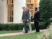 US President Bill Clinton with first lady Hillary Clinton and flanked by Transportation Secretary Rodney Slater walk from the Oval Office of the White House September 10, 1998 in Washington, DC. Clinton announced a tentative settlement in the 13-day-old strike by Northwest Airline pilots.