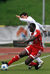 Theophile Ntame  of Primorje and Mirko Zaja of Interblock  at 29th Round of Slovenian First League football match between NK Interblock and NK Primorje at ZAK Stadium, on April 20, 2009, in Ljubljana, Slovenia. (Photo by Vid Ponikvar / Sportida)