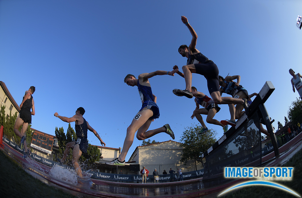 May 17, 2018; Los Angeles, CA, USA; Runners race over the water jump in the steeplechase during the USATF Distance Classic at Occidental College.