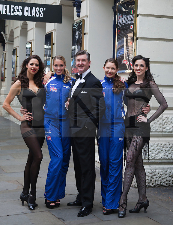 """© Licensed to London News Pictures. 30/06/2012. London, England. L-R: Djalenga Scott, Jenna Randall, Robin Cousins, Olivia Federici and Lauren Brooks. Olympic Gold Medallist Robin Cousins poses with Jenna Randall and Olivia Federici from Team GB's Synchronised Swimming Team, whom he mentors, and dancers from the musical Chicago. Robin Cousins will take up the role of """"Billy Flynn"""" in the musical Chicaco at the Garrick Theatre from 17 July 2012 for a limited season. Photo credit: Bettina Strenske/LNP"""