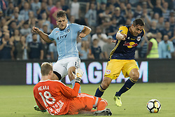 September 20, 2017 - Kansas City, Kansas, U.S - Sequence 02-04: NY Red Bulls goalkeeper Ryan Meara #18 makes the final interception for NY Red Bulls defender Aaron Long #33 (background-right) against Sporting KC forward Diego Rubio #11 (background-left) during the first half of the game. Sporting KC will win the 2017 Lamar Hunt Open Cup championship with a score of 2-1 over the New York Red Bulls. (Credit Image: © Serena S.Y. Hsu via ZUMA Wire)