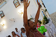 Homeless poor man at the front of the service. Often the lines between Candomble and Catholicism are blurred. This is especially true with the Sao Lazaro event in late January in Salvador, Bahia, Brazil, the city which is known as the home of Candomble. Sao Lazaro represents healing and the sick.