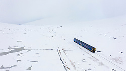 A Scotrail train travels through heavy snow at Corrour on it's way from Mallaig to Glasgow on the West Highland Line. The Station is the highest railway in Britain
