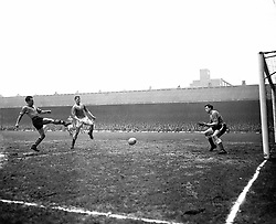 (L-R) Wolverhampton Wanderers' Norman Deeley fires in a shot at goal, watched by Leicester City's Tony Knapp and goalkeeper Gordon Banks