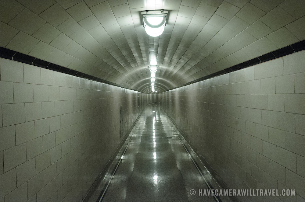One of the corridors inside the thick concrete wall of the Hoover Dam. This particular corridor is tiled, but most of them are just bare concrete.